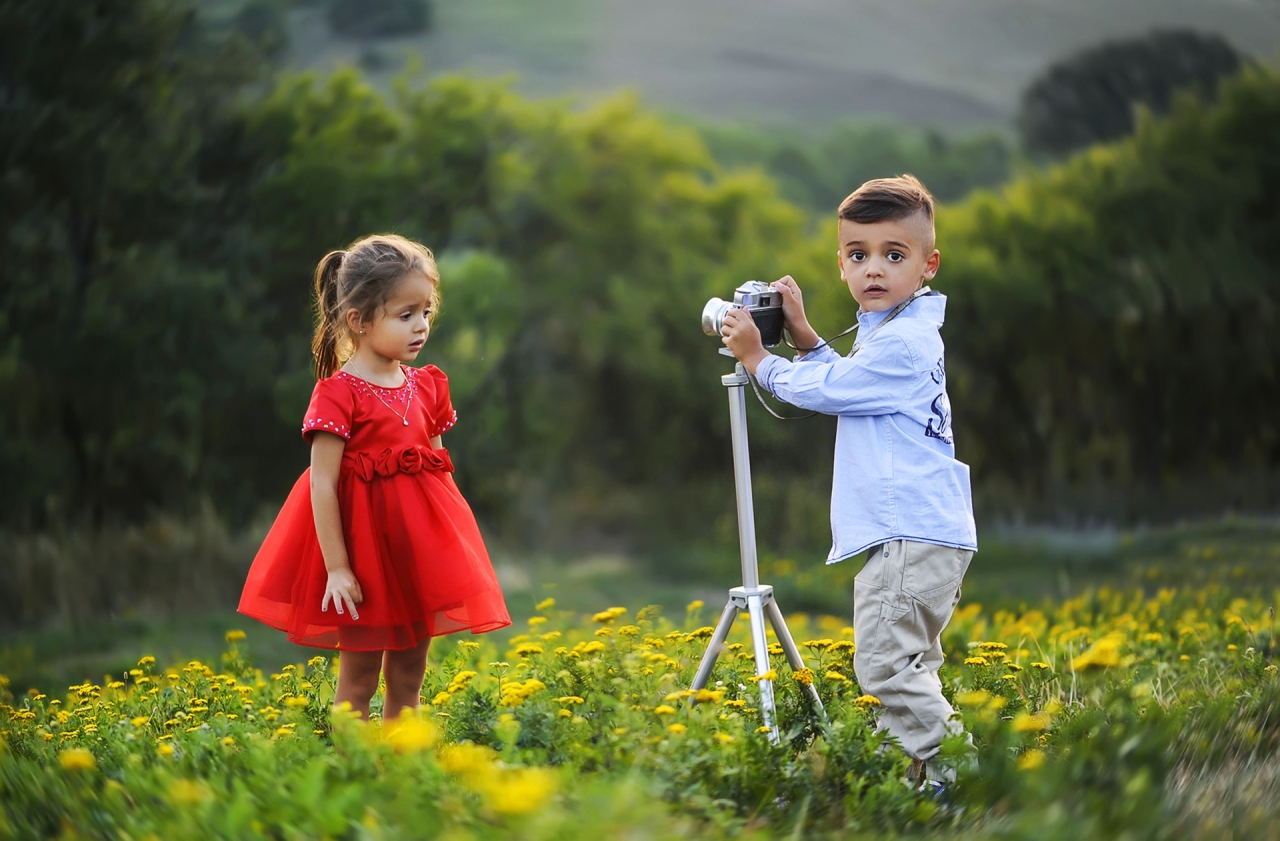 Children taking photo session on the meadow