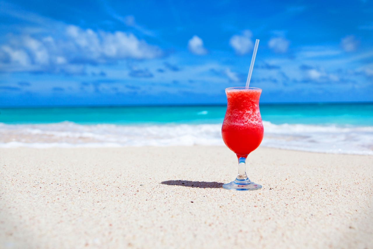 Cocktail and drink on an exotic Caribbean beach