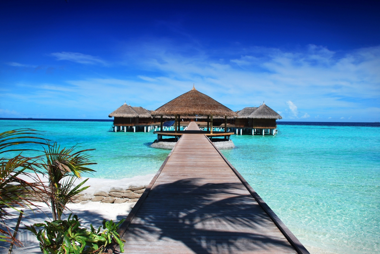 Holiday houses in Maldives, sea and sandy beach