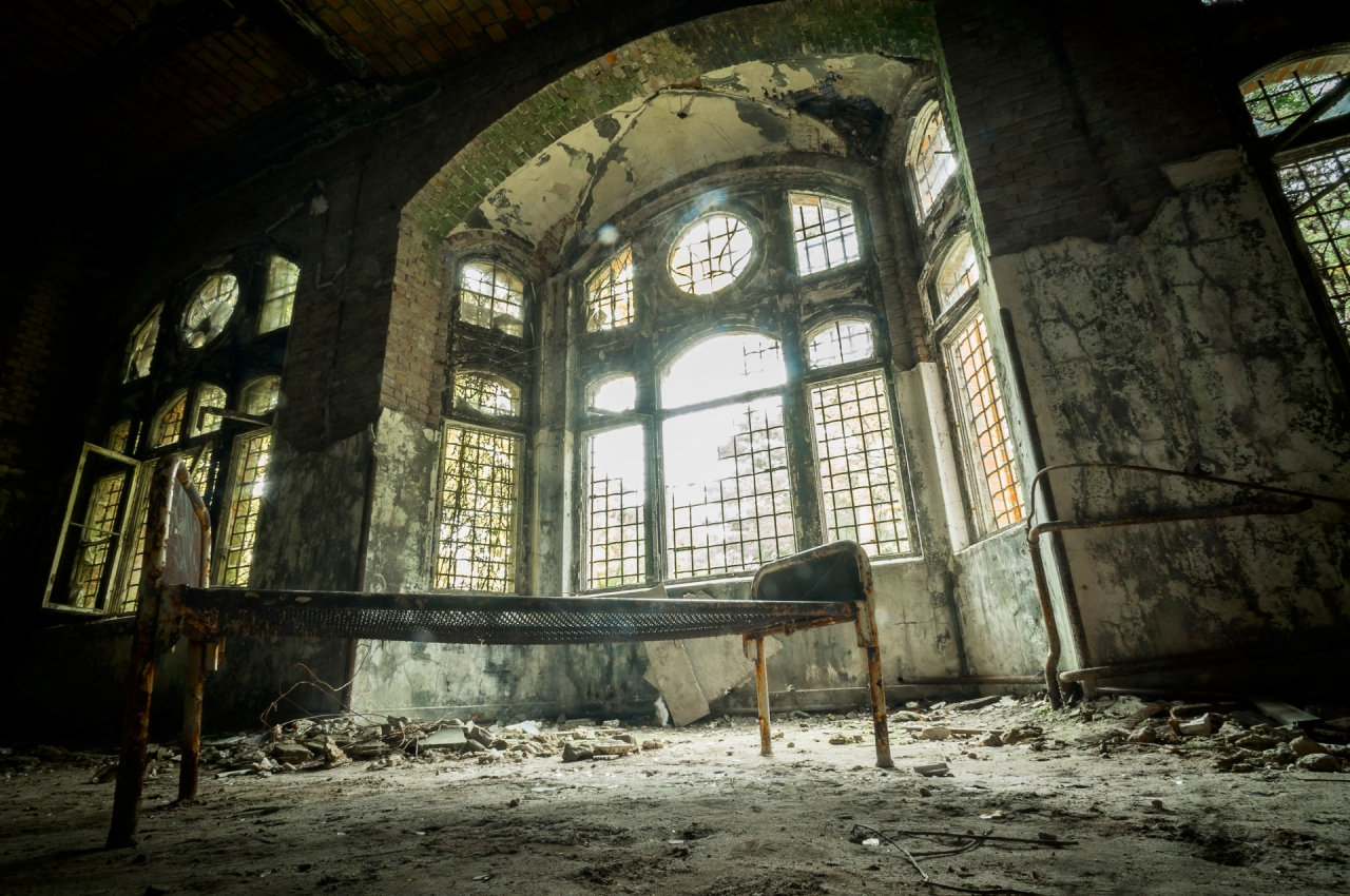 Abandoned hospital with bed and windows