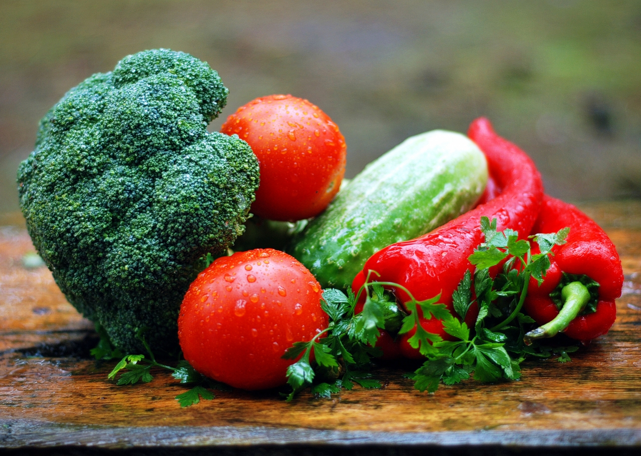 Healthy vegetables on wooden plate