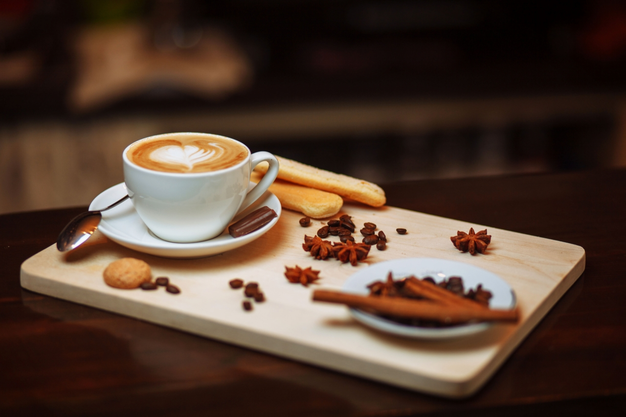 Cappuccino coffee with biscuits and cinnamon