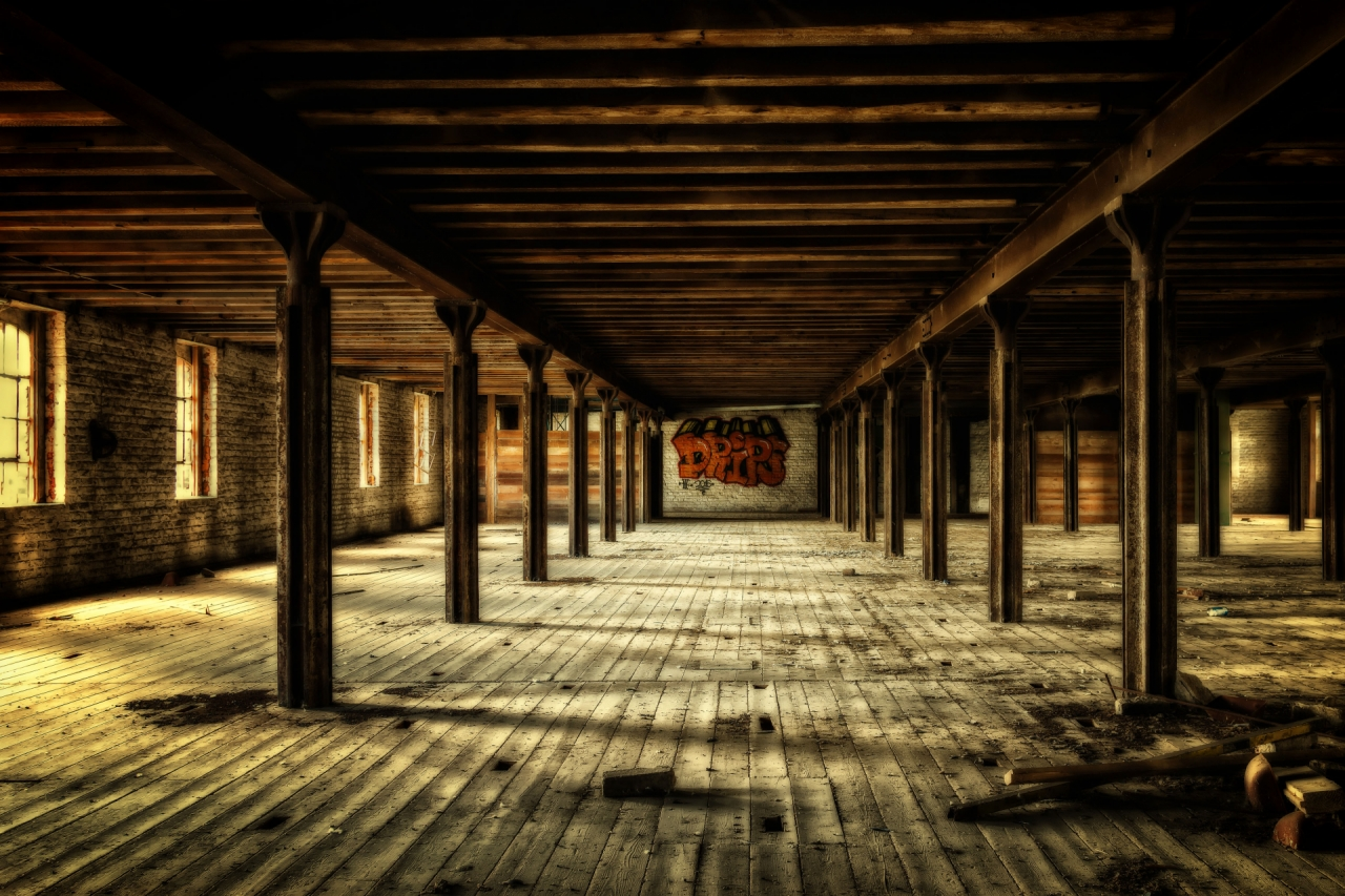 Abandoned building inside with wooden floor and ceiling