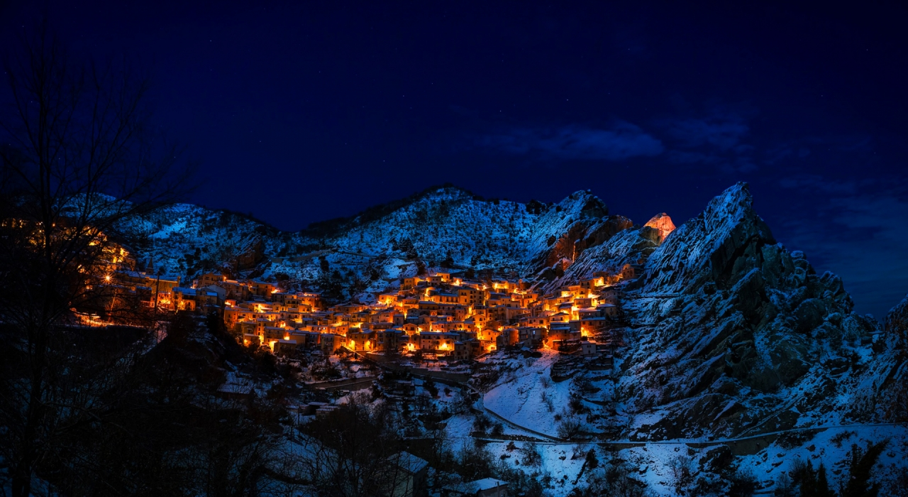 Castelmezzano Village in Italy between the snowy mountains in winter