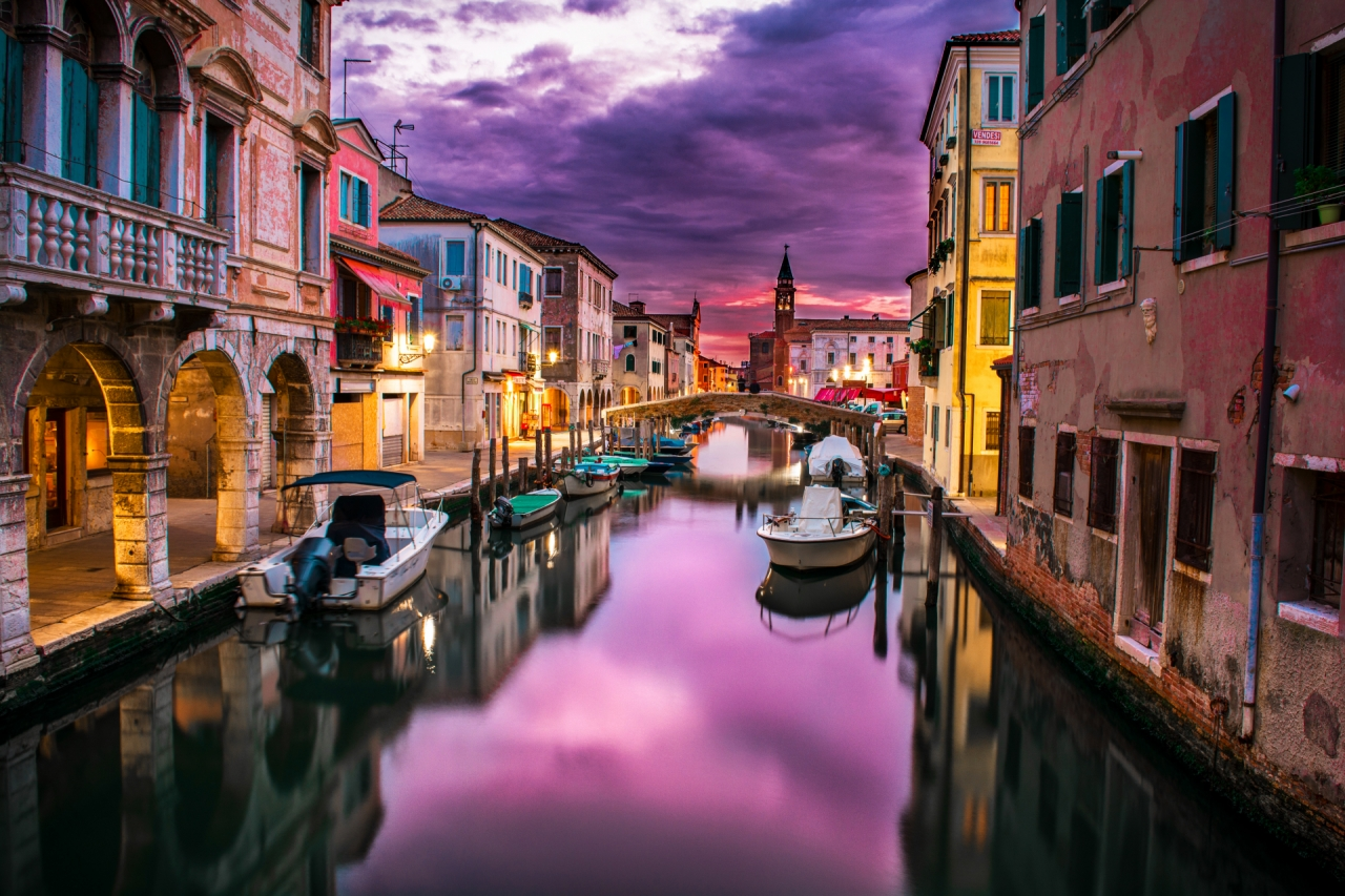 Boats in canal in Venice during the sunset