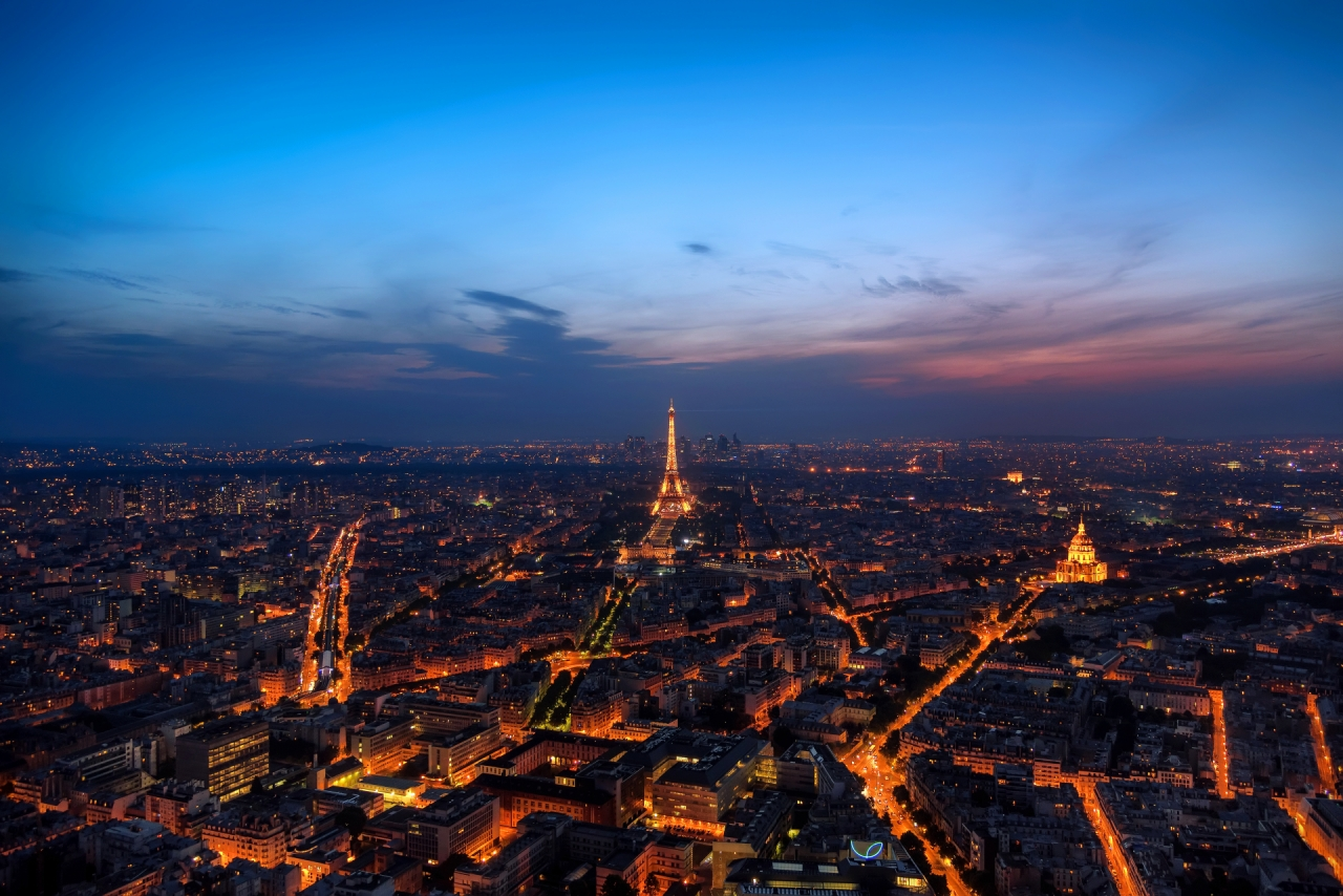 Aerial photo of Eiffel Tower and Paris during the night