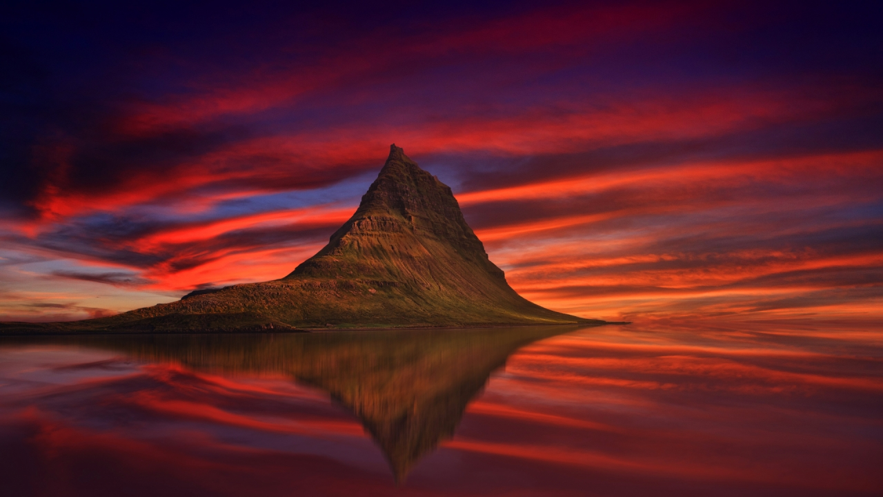 Kirkjufell mountain in Iceland during the sunset