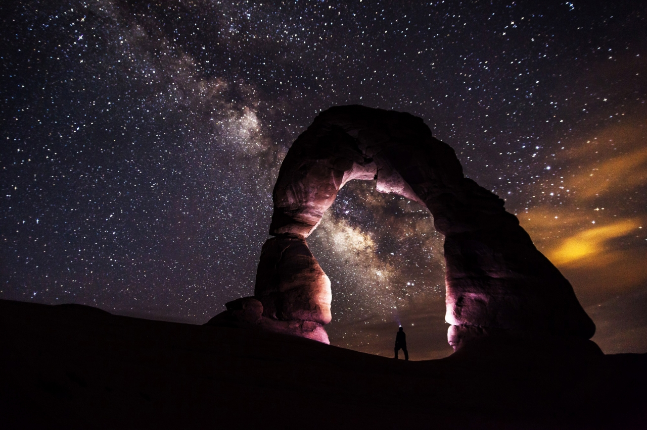 Delicate Arch during the night with a man, United States USA
