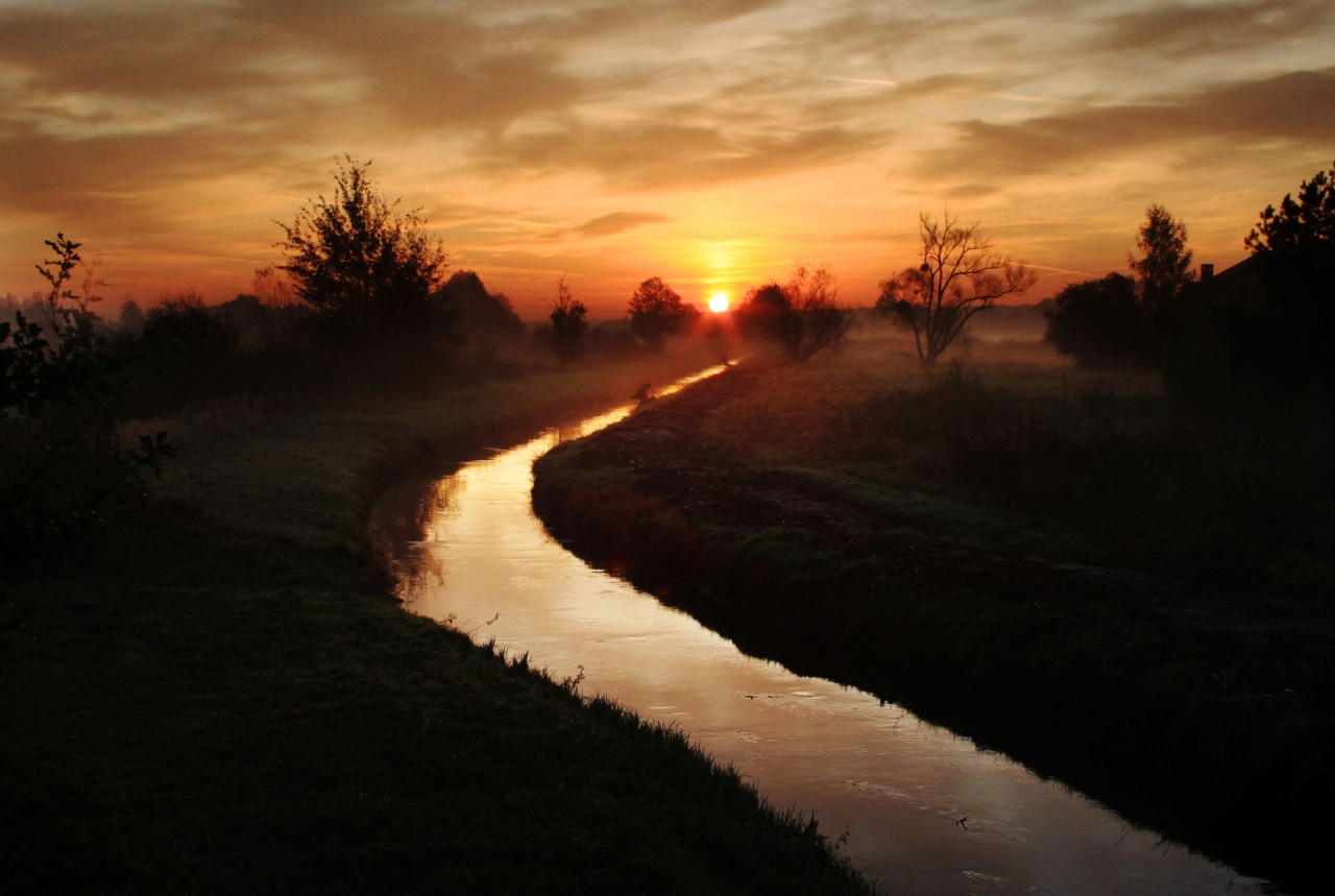 Sunrise above the river in Poland