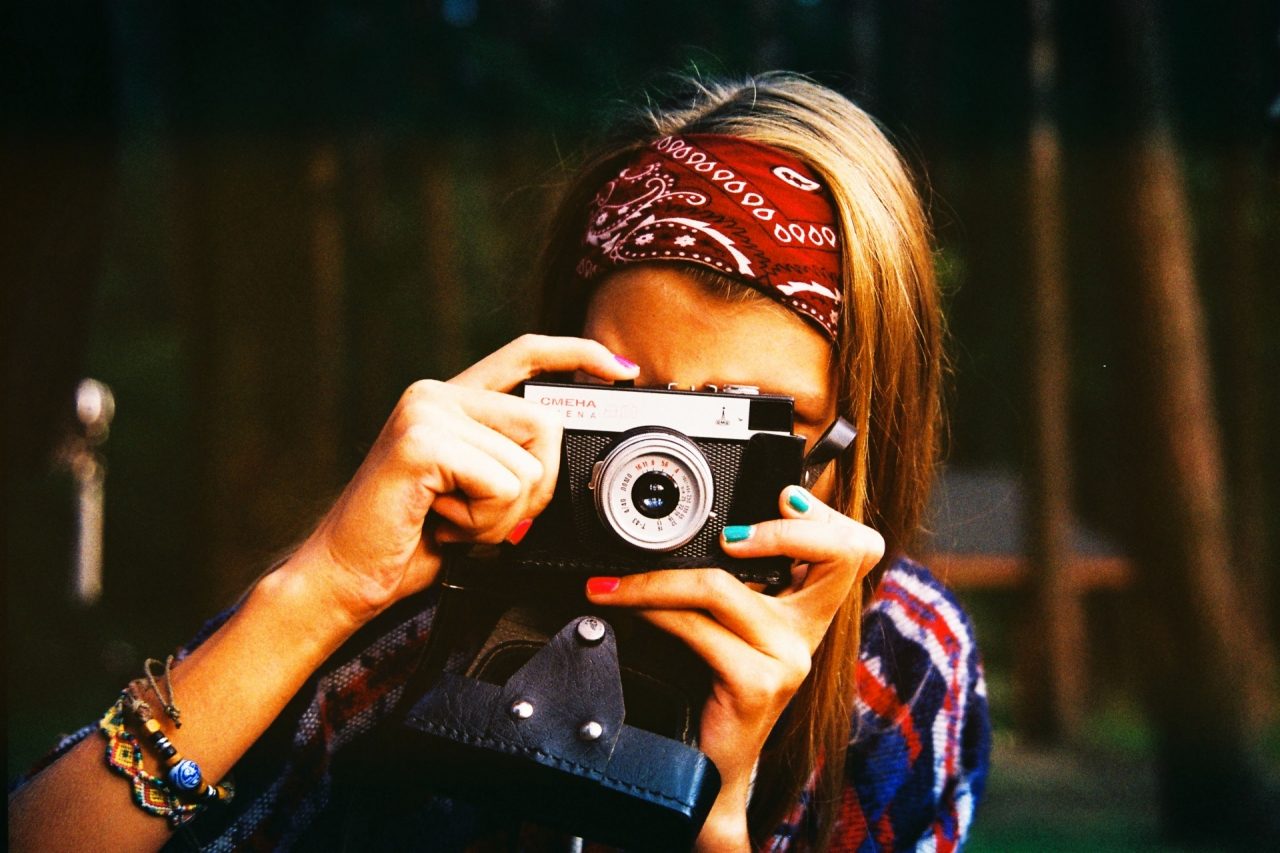 Colorful hippie girl with a camera